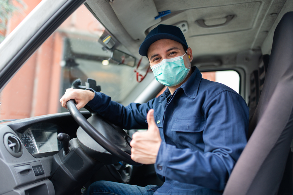 truck driver wearing ppe mask
